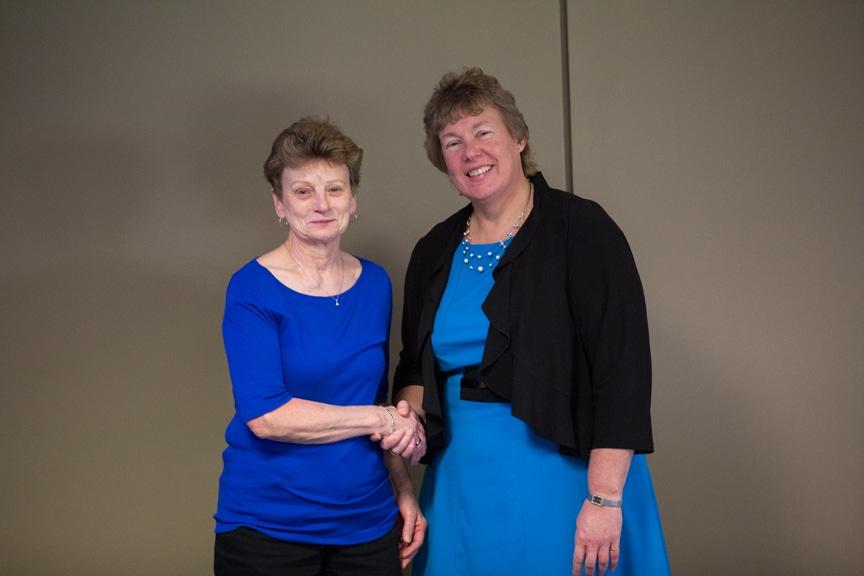 Moraine Park Retirement Service Recognition retiree shaking hands with Bonnie Baerwald
