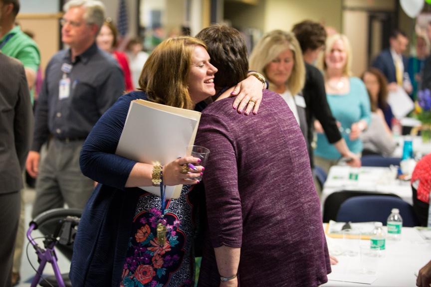 Moraine Park Retirement Service Recognition event people hugging
