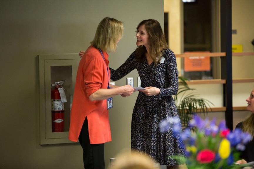Kathy Broske talking to Karen Coley at retirement event