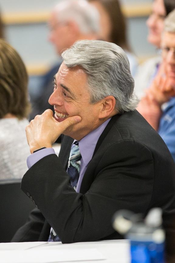 Dr. Stan Cram listening at retirement event