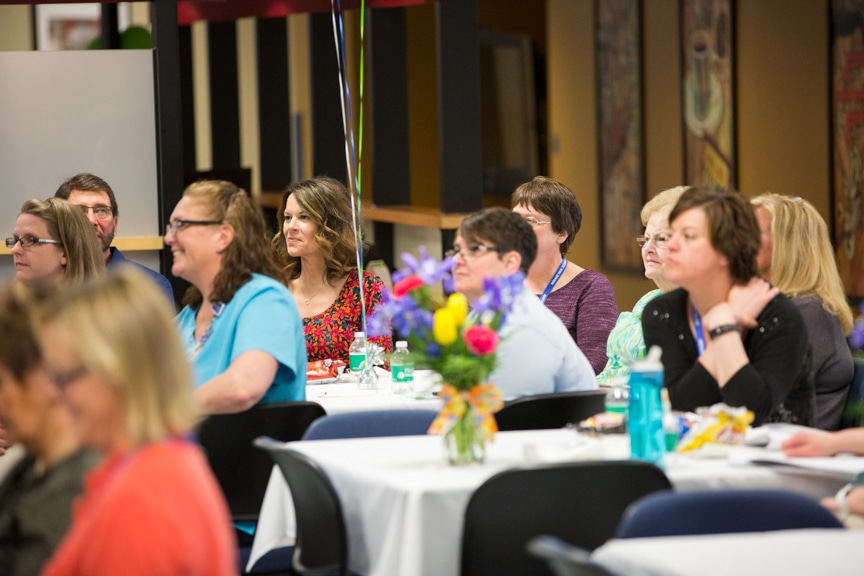 employee listening to speaker at Retirement-Service Recognition event