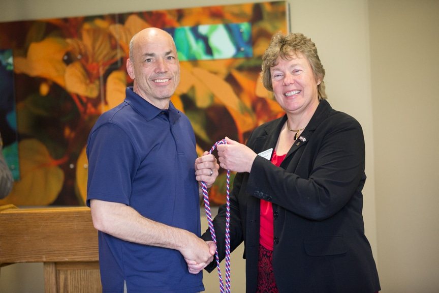 Moraine Park president Bonnie Baerwald shaking hands of veteran