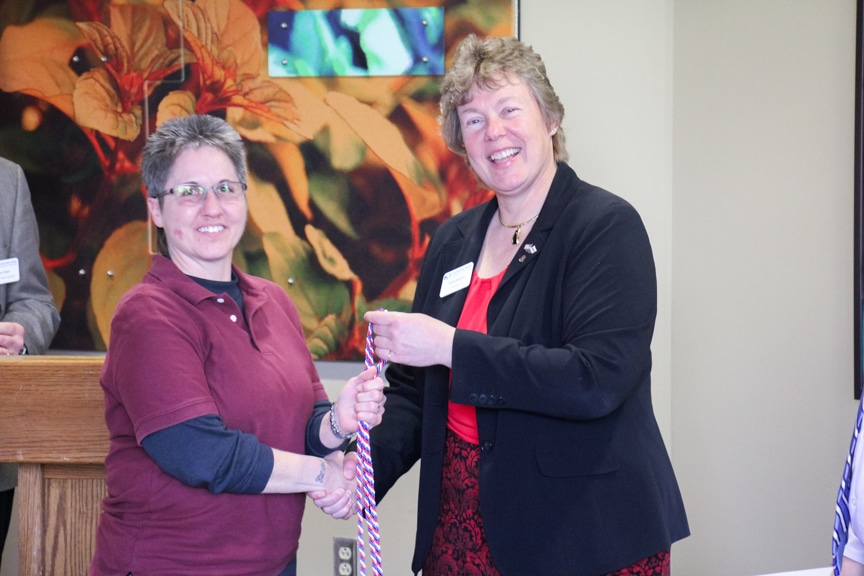 Moraine Park president Bonnie Baerwald shaking hands of veteran