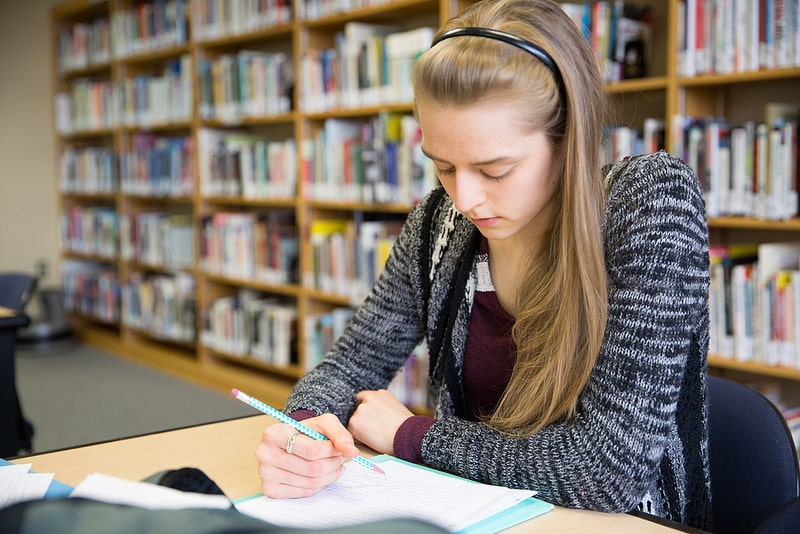 Female student studies at table in Moraine Park library