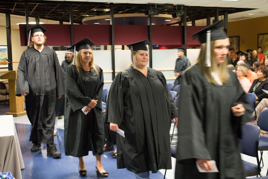 Graduates march in at Moraine Park GED-HSED graduation ceremony