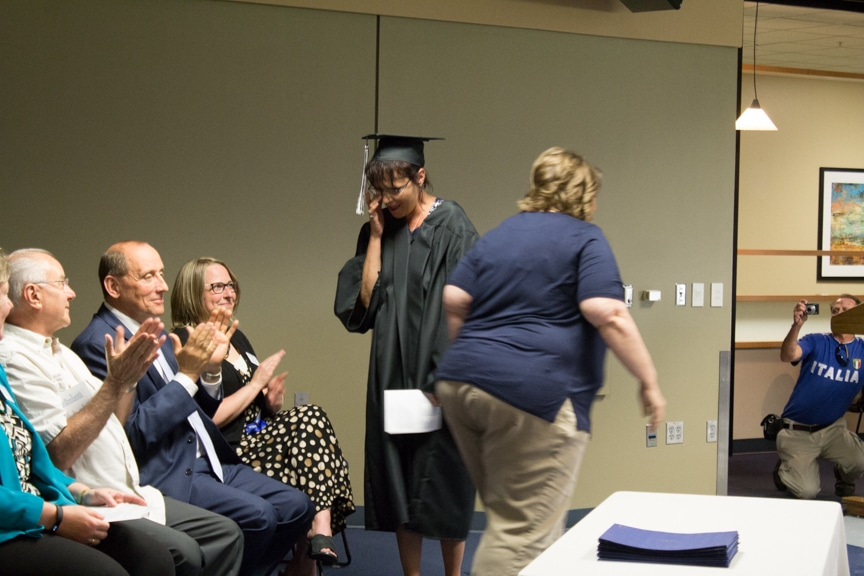 Female graduate wipes away tear at GED-HSED Gradudation Ceremony