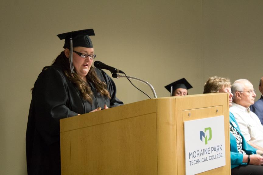 Student speaks from podium at GED-HSED Gradudation Ceremony