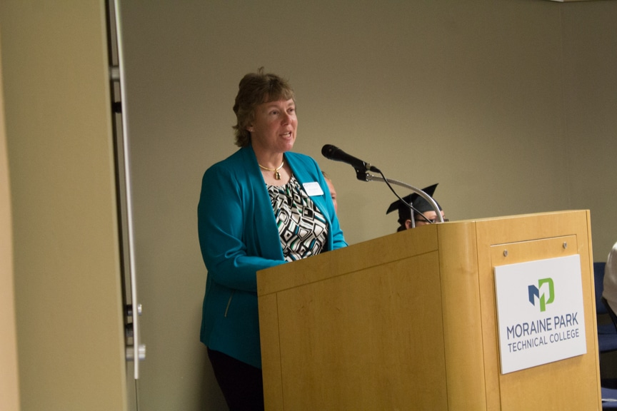 President Bonnie Baerwald speaks from podium at GED-HSED Gradudation Ceremony