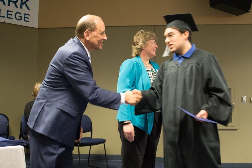 Male graduate recieves diploma at GED-HSED Gradudation Ceremony