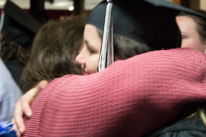 Graduate recieves hug from woman after GED-HSED Gradudation Ceremony