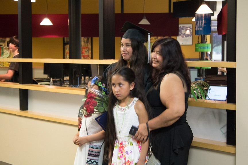 Family members pose for photo with female graduate