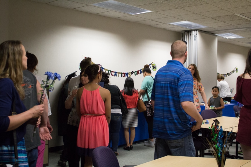 Families chat in room at GED-HSED Gradudation Ceremony