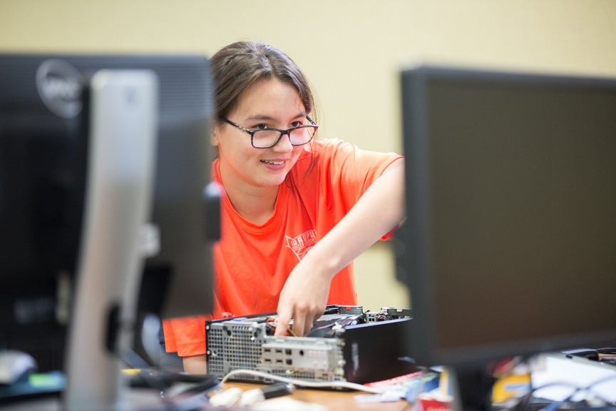 Girl assembles computer at Moraine Park summer camp