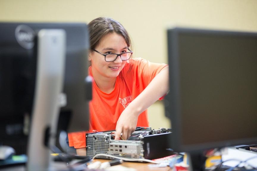 Girl assembles computer at Moraine Park summer camp