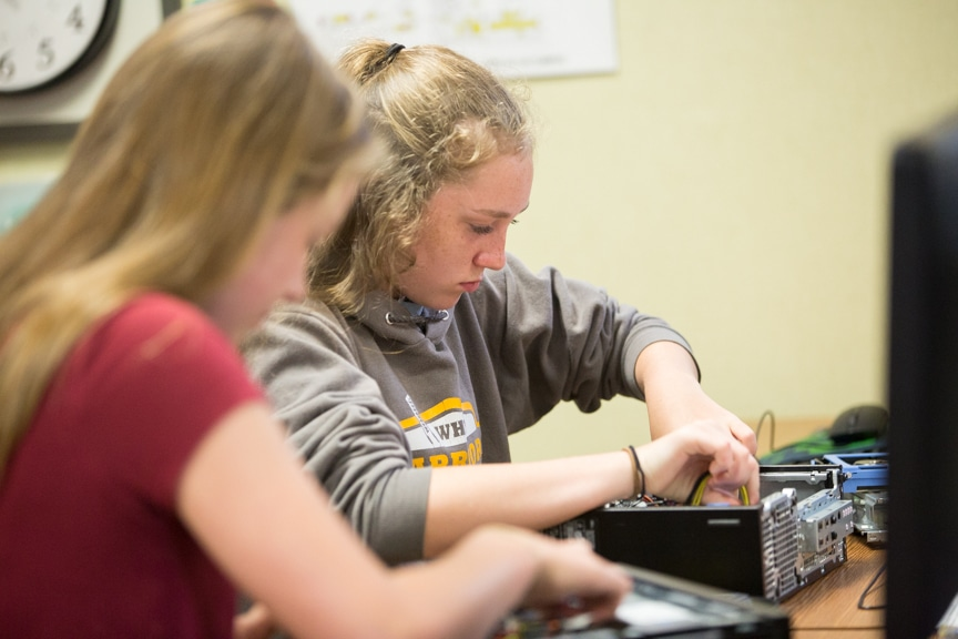 Girls work on assembling computer towers at Moraine Park summer camp