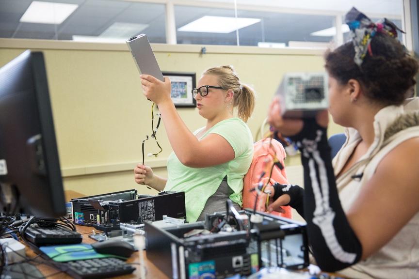 Girls assemble PC computer at Moraine Park Girls Make IT Happen camp