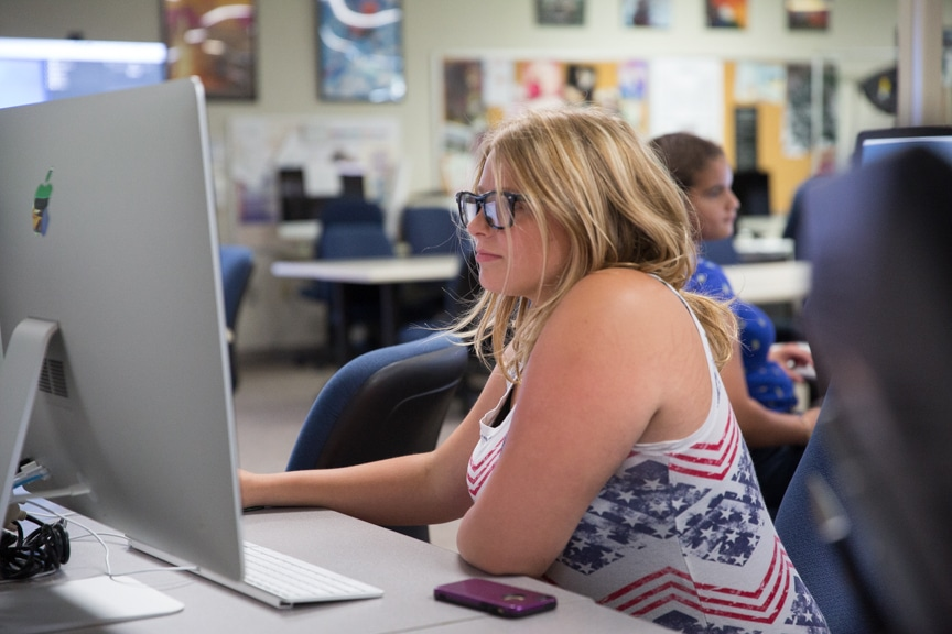 Girl looks at iMac computer screen during Moraine Park summer camp