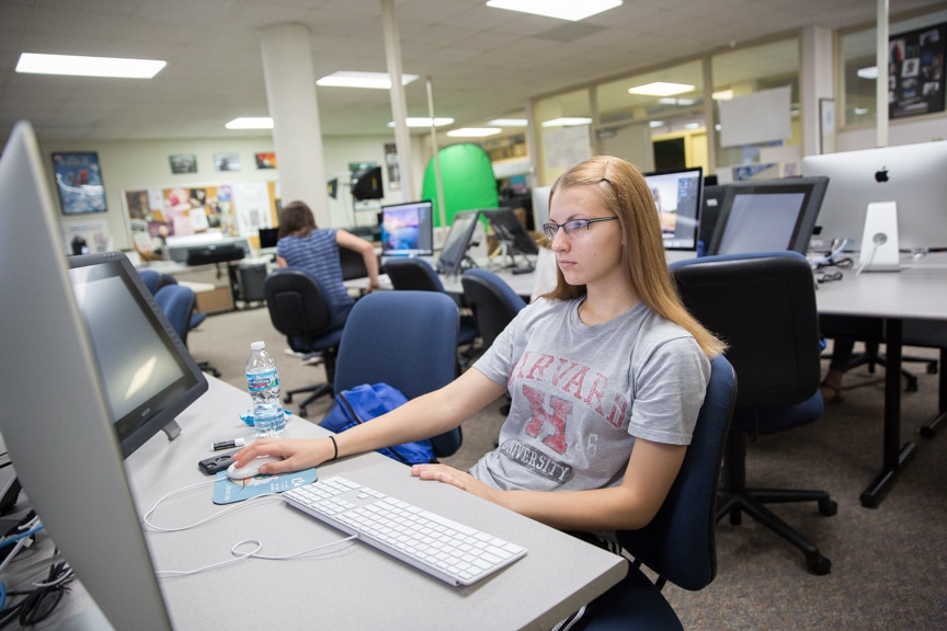 Girls work in Photoshop on iMac computer at Moraine Park summer camp