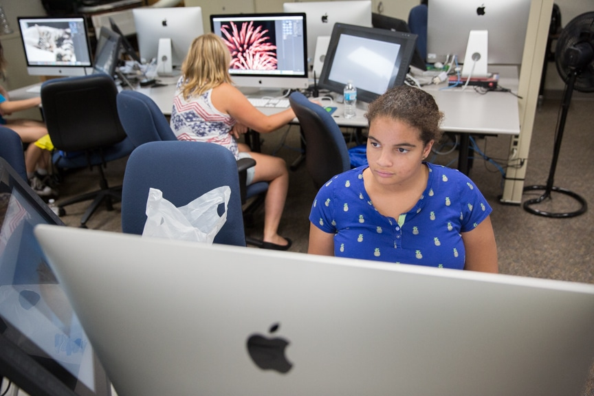 Girls work on Mac computers at Moraine Park summer camp