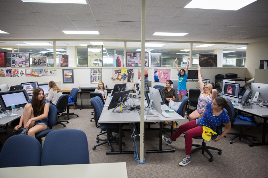 Classroom of girls work at Mac computers at Moraine Park summer camp