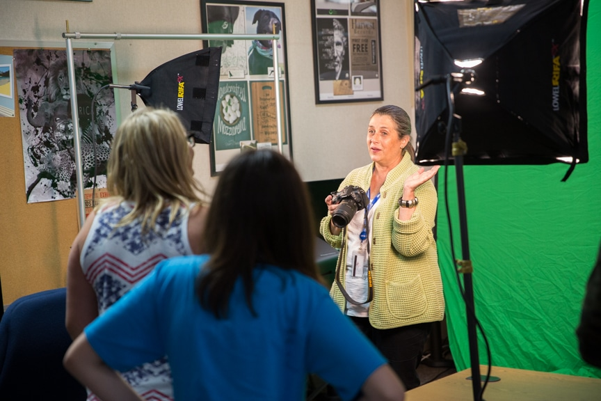 Instructor explains camera features during photography project at Moraine Park summer camp