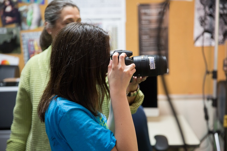 Girl takes photo with camera during Moraine Park summer camp