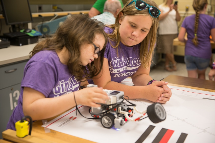 Two girls work on Lego robot during Moraine Park summer camp