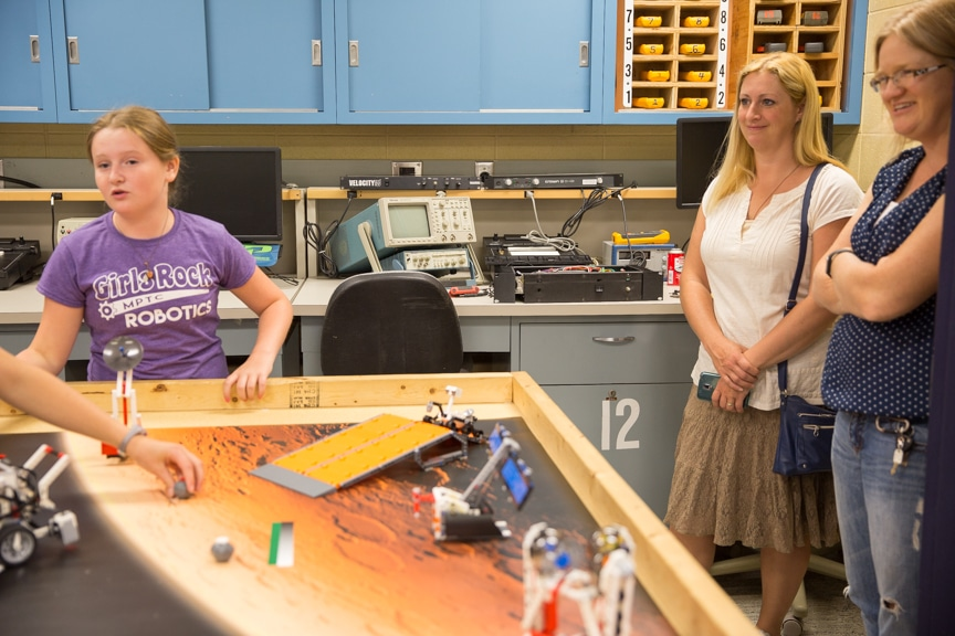 Family members watch as girls display lego robotics projects at Moraine Park summer camp