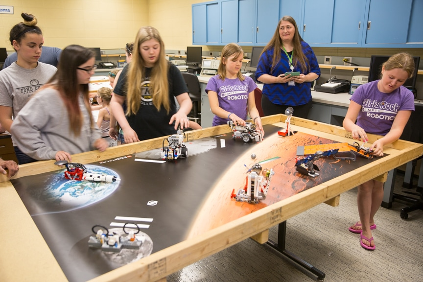 Girls control lego robots built during Moraine Park summer camp