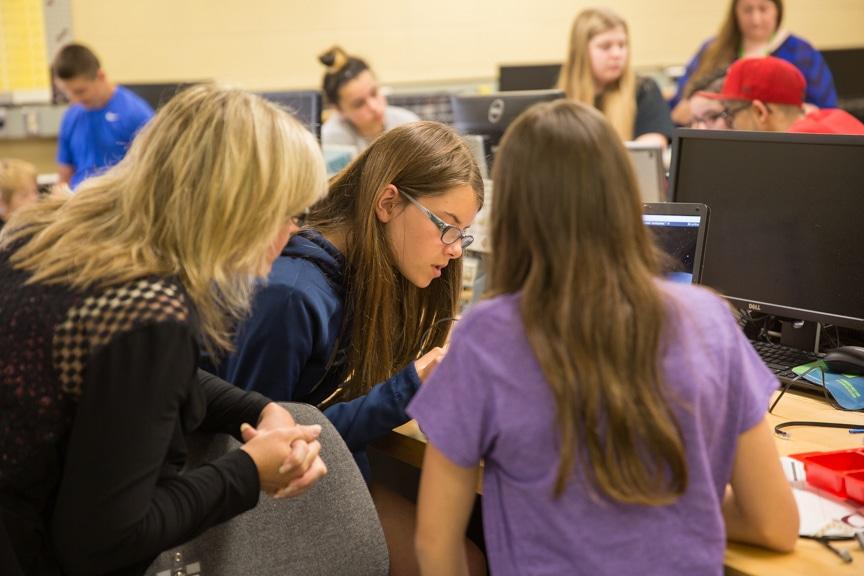 Girls work on robotics project