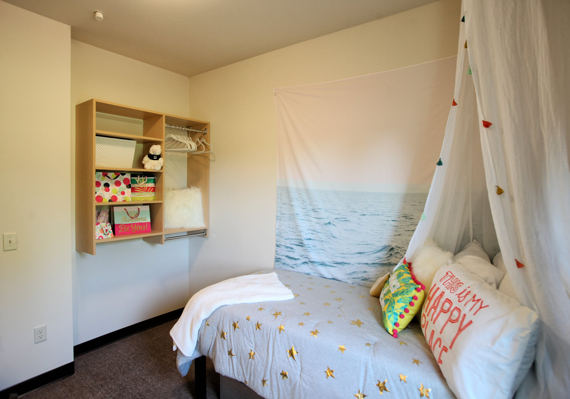 Vue campus bedroom with shelf on wall