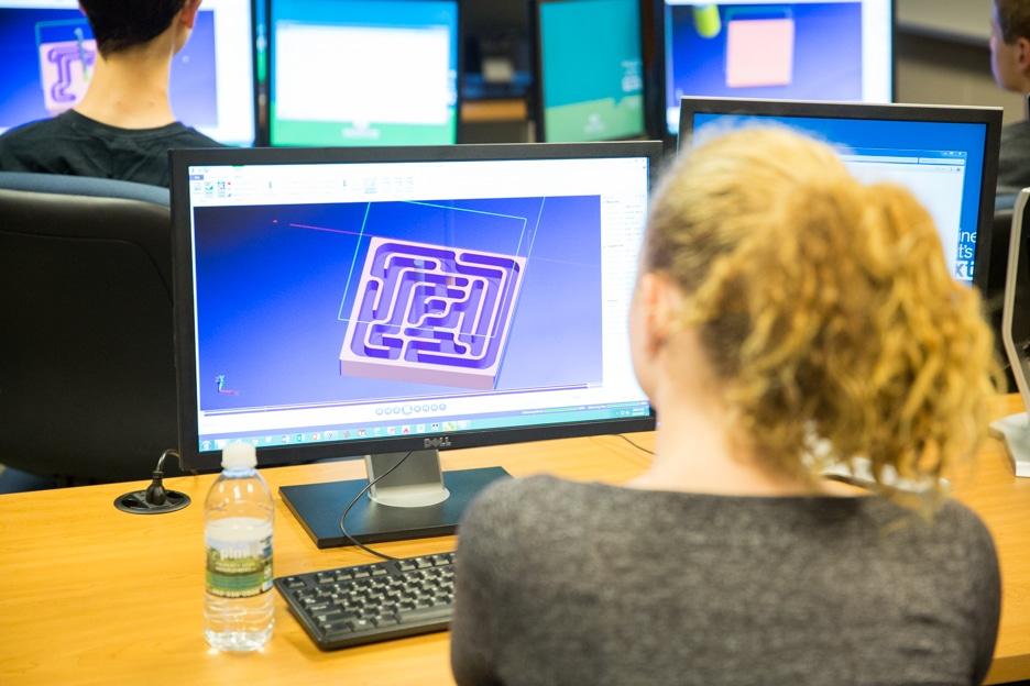 Girl designing maze on computer at Moraine Park.