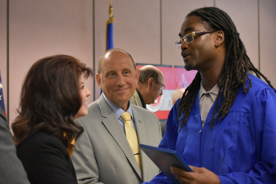 Moraine Park graduate shakes hand
