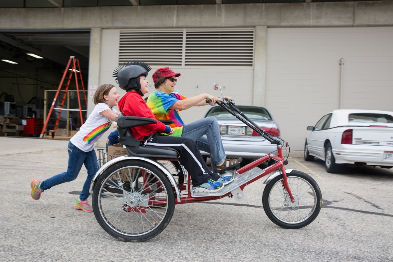 Mason and women on trike and two children behind