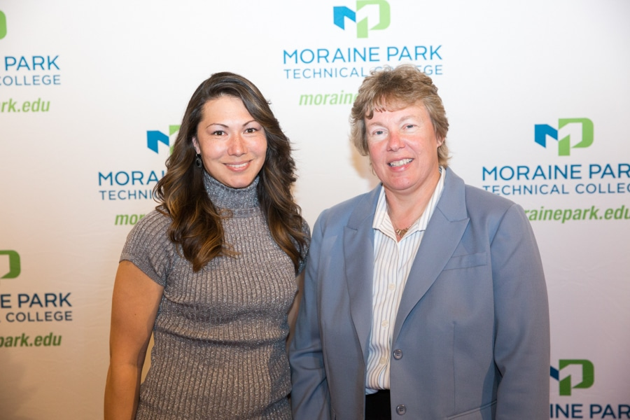 Moraine Park president Bonnie Baerwald standing with Carla Stephany at student award banquet