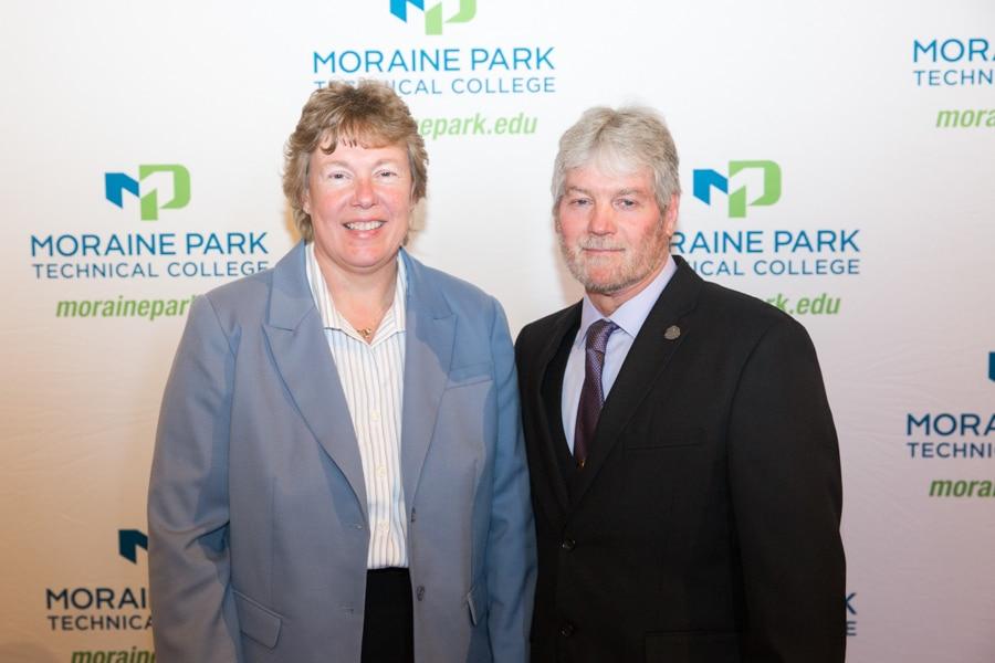 Moraine Park president Bonnie Baerwald standing with Dewayne Sexton at student award banquet