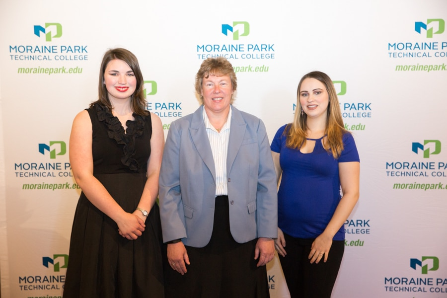 Moraine Park president Bonnie Baerwald with two female students at Student awards banquet