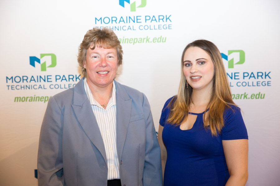 Moraine Park president Bonnie Baerwald with female student at Student awards banquet