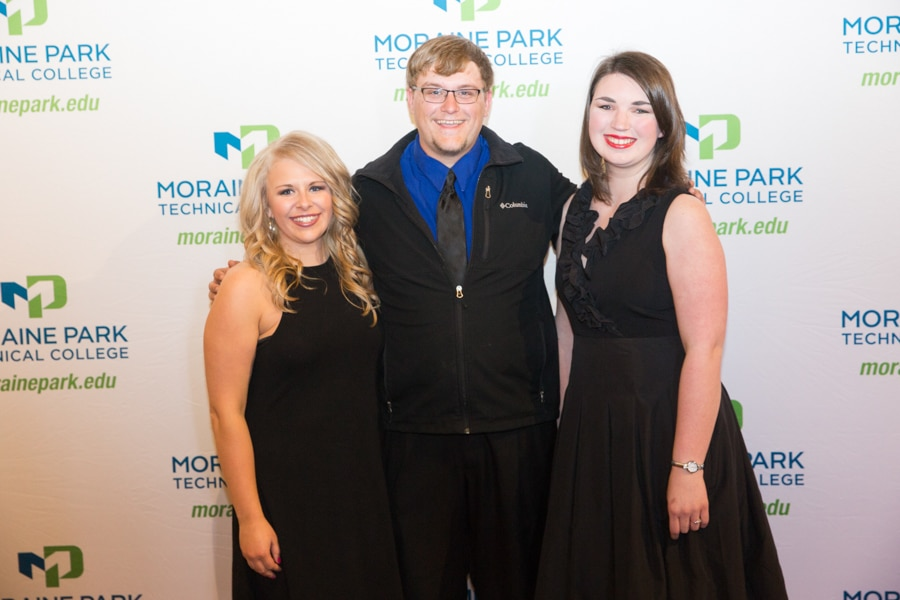 One male and two female Moraine Park students at Student Awards Banquet