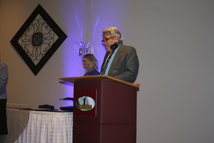 Dr. Stan Cram speaking from podium at student awards banquet