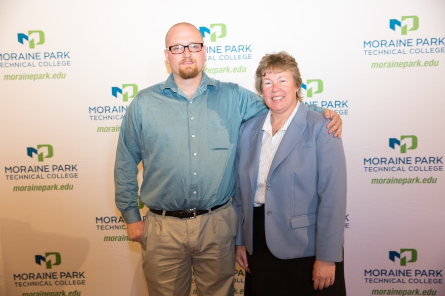 Moraine Park president Bonnie Baerwald and male student at Student Awards Banquet