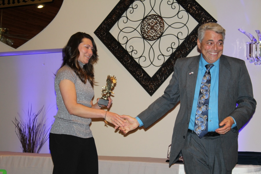 Carla Stephany accepted award from Dr. Stan Cram at Student Awards Banquet