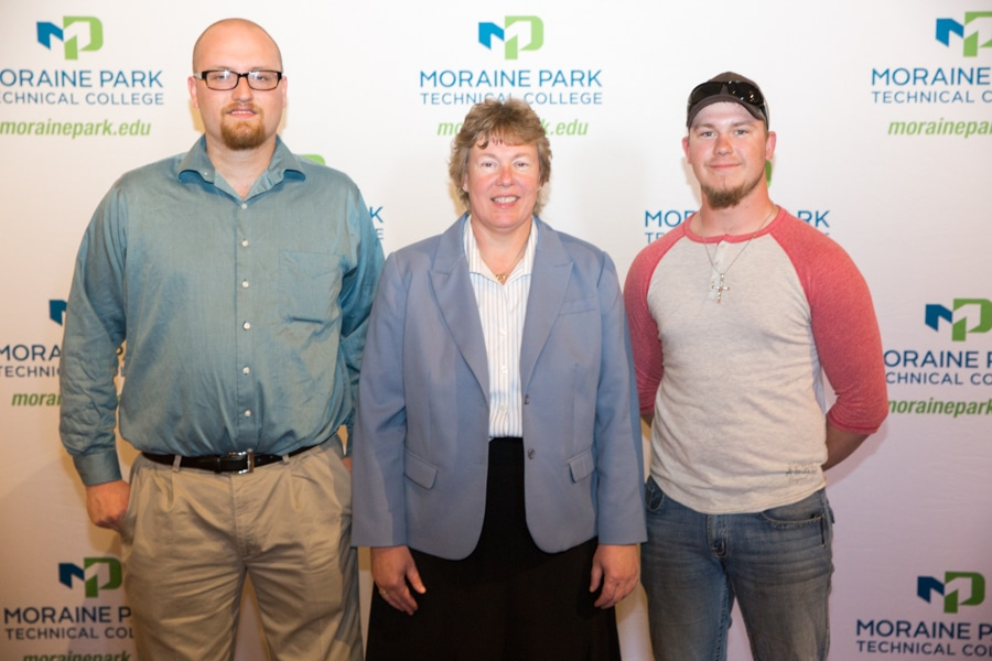 Moraine Park president Bonnie Baerwald and two male students at Student Awards Banquet
