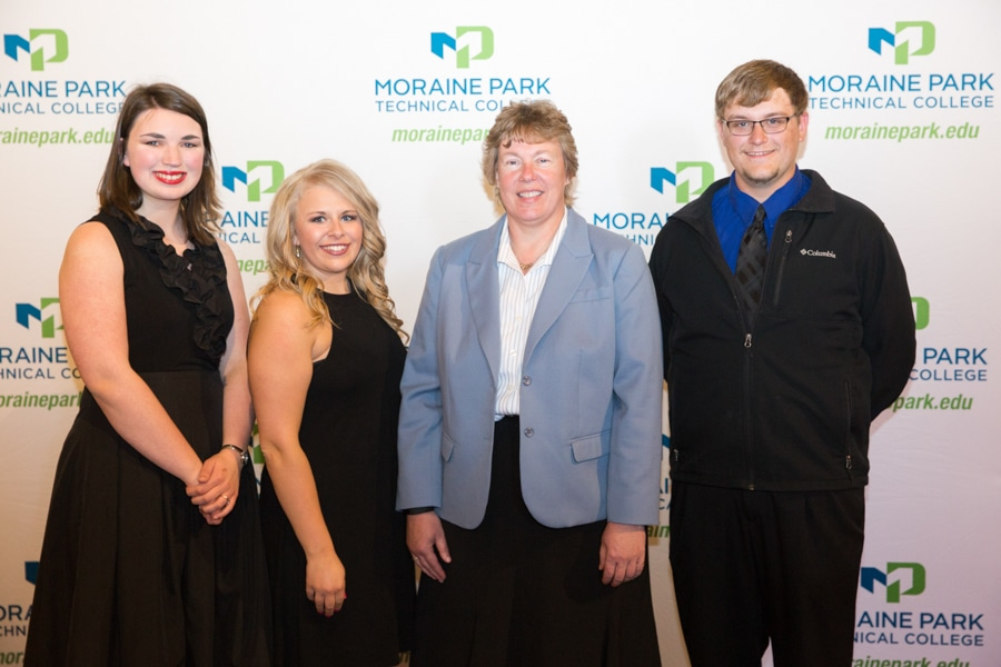 Moraine Park president Bonnie Baerwald and two female and one male Moraine Park students at student awards banquet