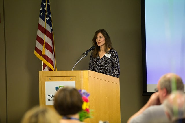 Kathy Broske speaks to college staff at podium