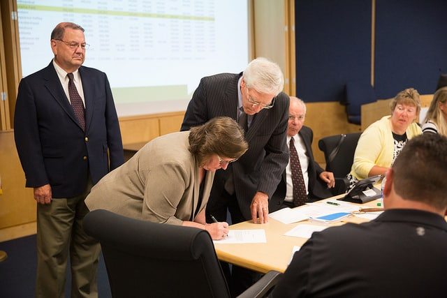 Cynthia Laubenstein signs paperwork to officially become part of Moraine Park district board