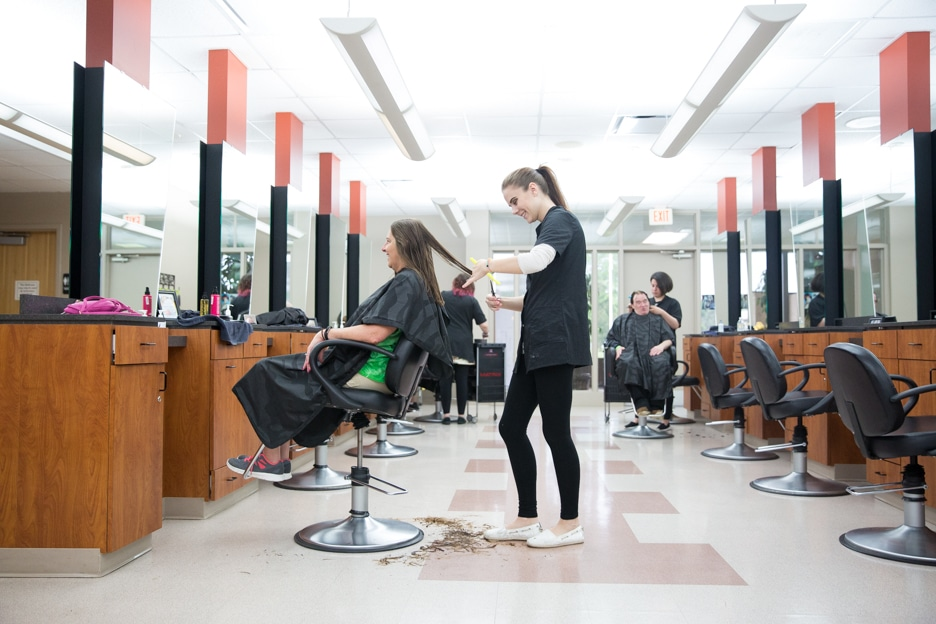 Cosmetology student cuts hair in Moraine Park's Fond du Lac salon