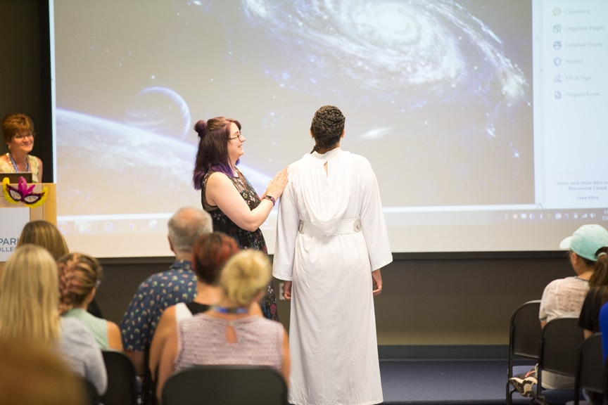 Cosmetology student explains Star Wars-inspired hairstyle of model at Moraine Park fashion show