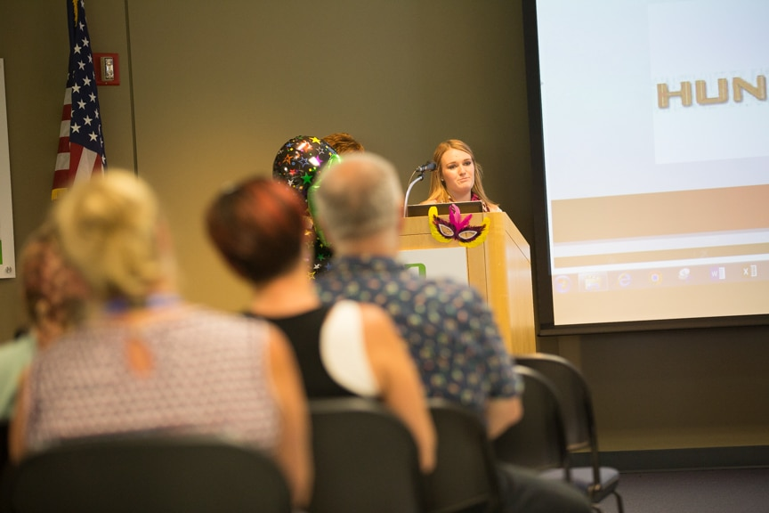 Student speaks at podium during Moraine Park summer fashion show