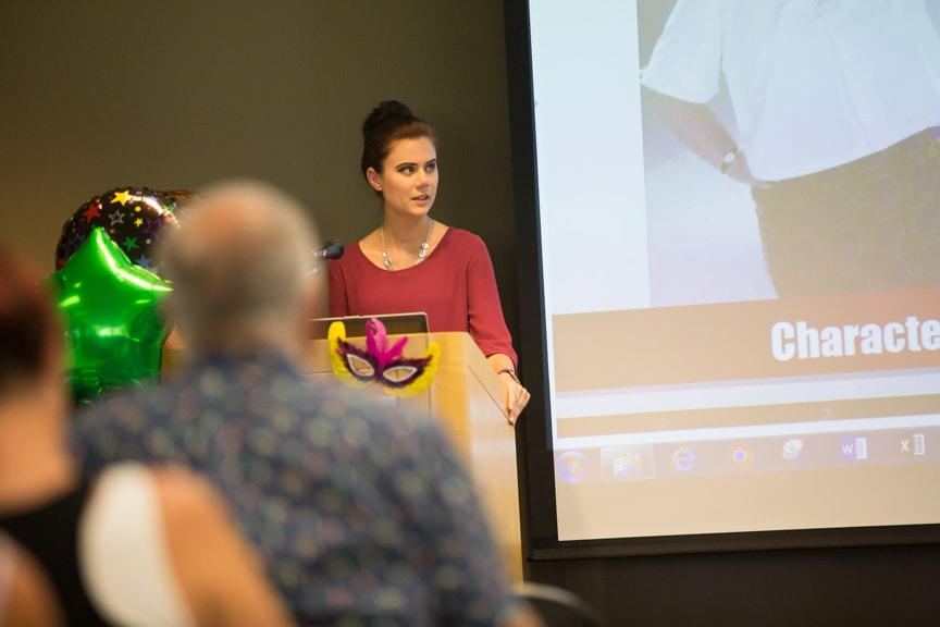 Student speaks from podium at Moraine Park summer fashion show